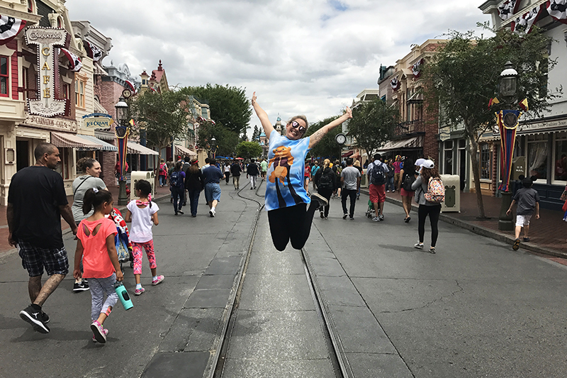 marnie jumping into the air at main street usa disneyland
