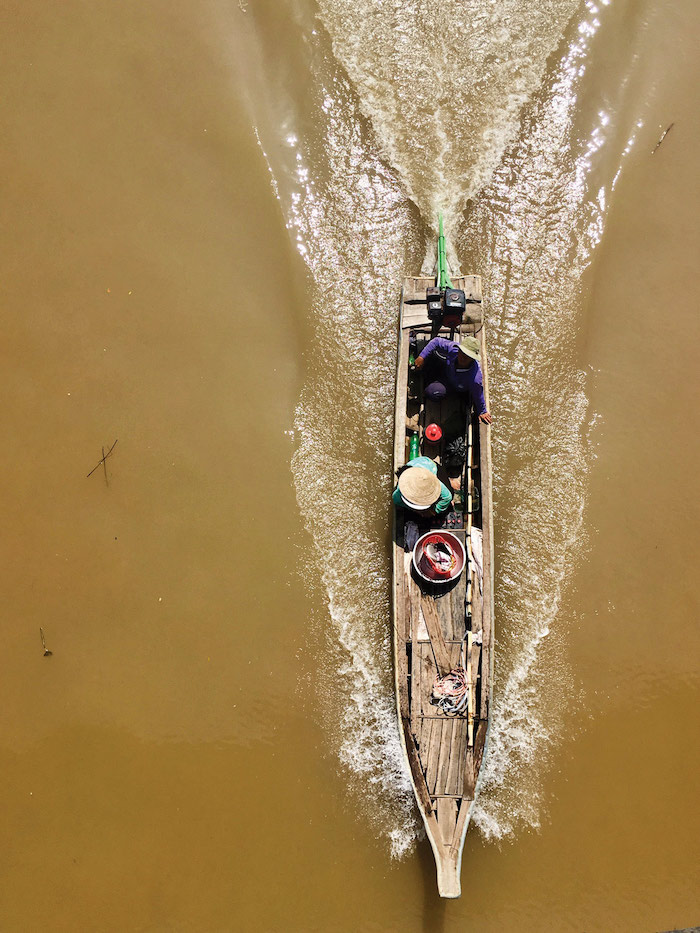 a view of a river boat from above near Evergreen Island, Vietnam - Mekong River cruise