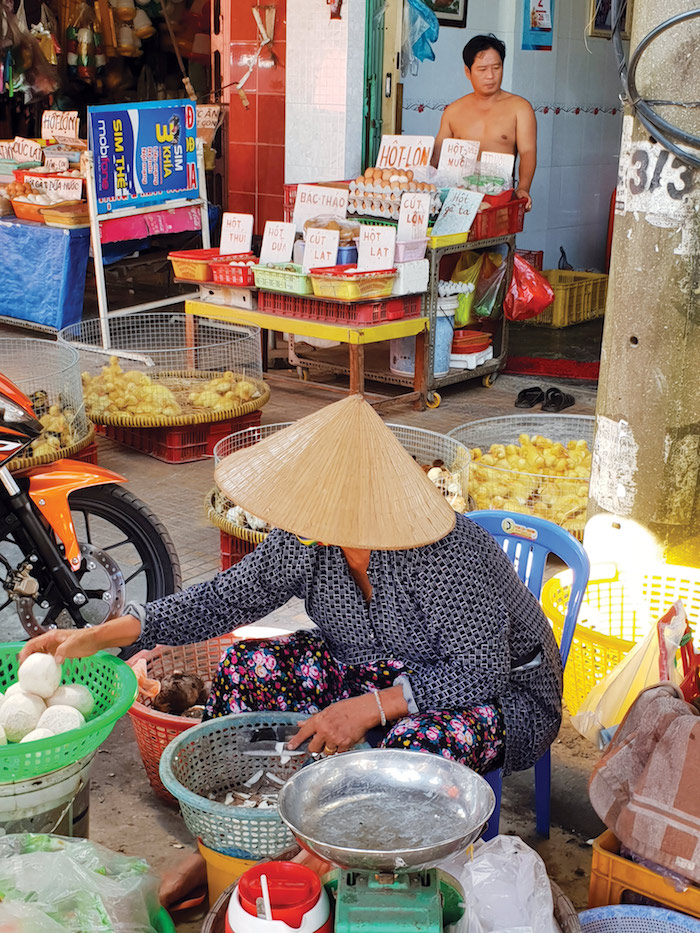 locals at the markets in Sa Dec Vietnam