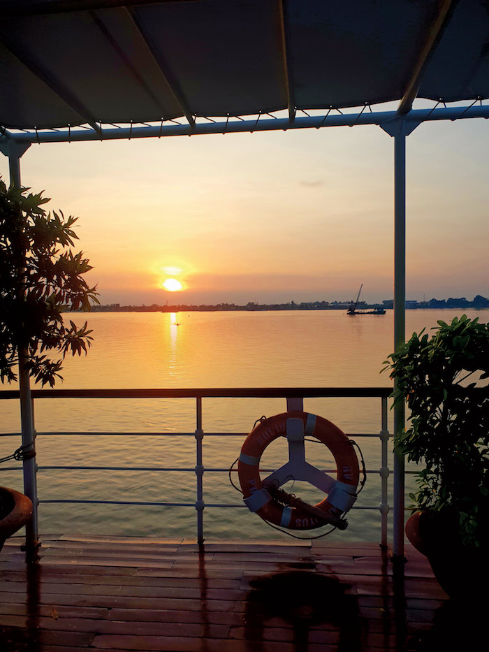 sunset from the deck of an APT river cruise down the mekong river