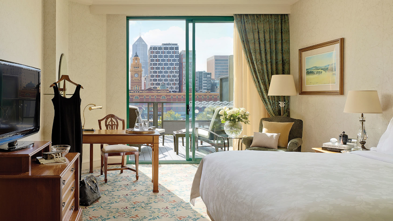 Interior of a Langham Hotel room with view of Melbourne Skyline