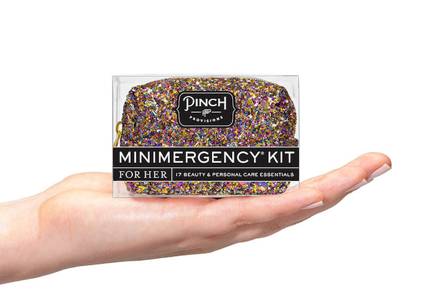 A hand holding one of the minimergency kits