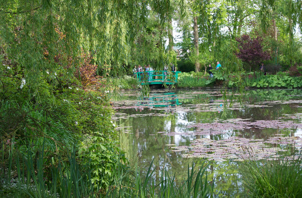A footbridge and waterlilies at Monet's Gardens in Giverny, France.