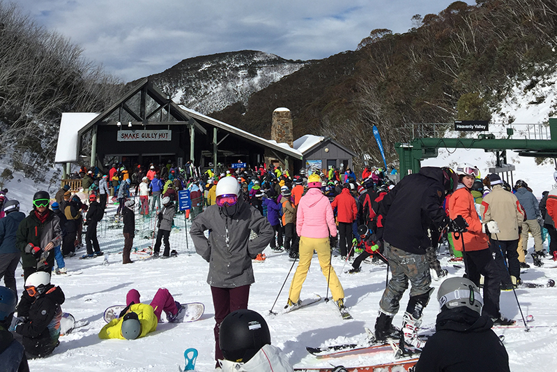 Skiers wait for the chairlift at Mount Hotham