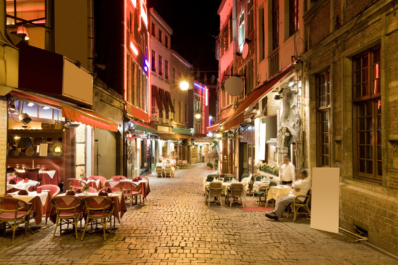 Restaurants line a cobbled alley in the Belgian city of Brussels.
