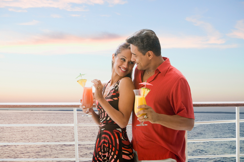 two passengers with colourful cocktails on a cruise ship