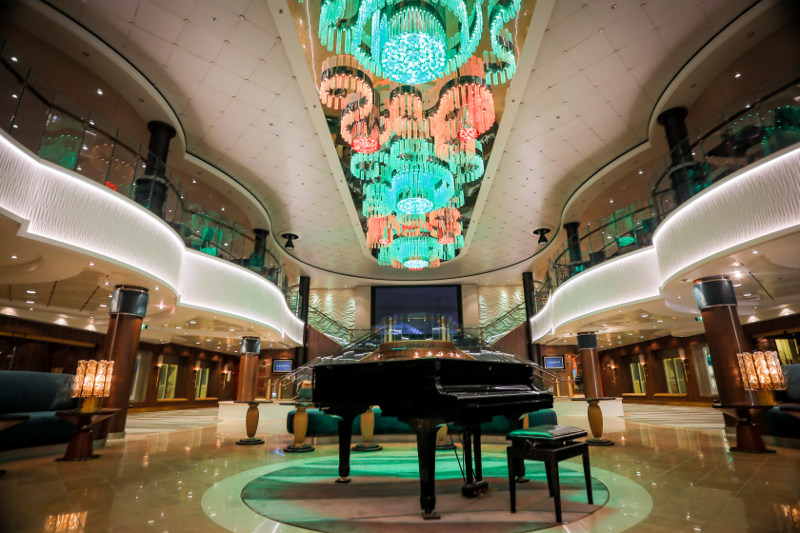 A grand piano graces the revamped atrium on board the Norwegian Jade cruise ship.