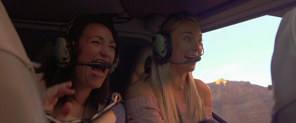 greer and kelly in helicopter over grand canyon