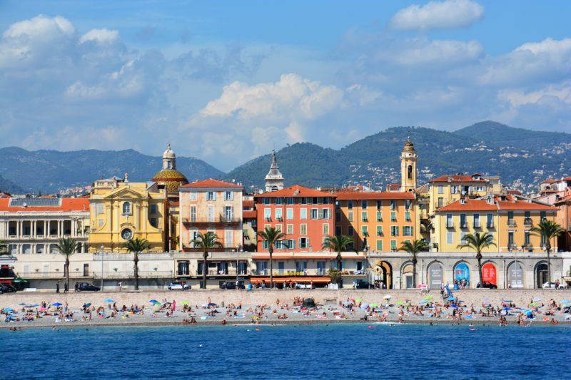 Image taken from the ocean looking back at Nice Beach in France. Buildings in the background