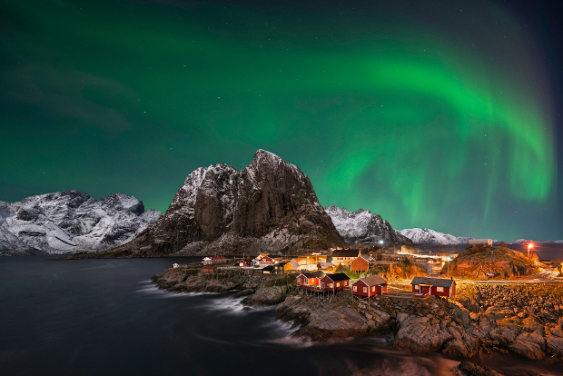 The Northern Lights sparkle over Hamnoy in the Lofoten Islands, Norway