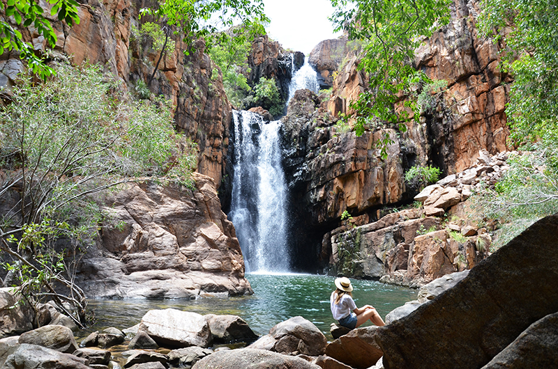 girl in front of waterfall