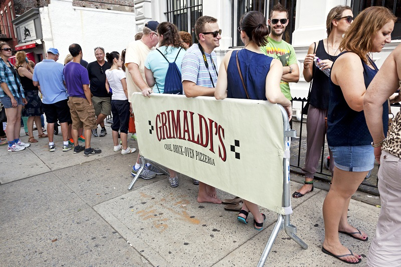 People lining up outside the famous Grimaldi's pizzeria in Brooklyn. Image: Getty