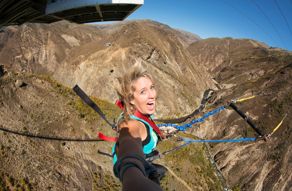 A woman screams at AJ Hackett Bungy's attraction in Queenstown, New Zealand.