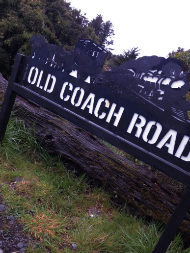 A photo of the Old Coach Road sign