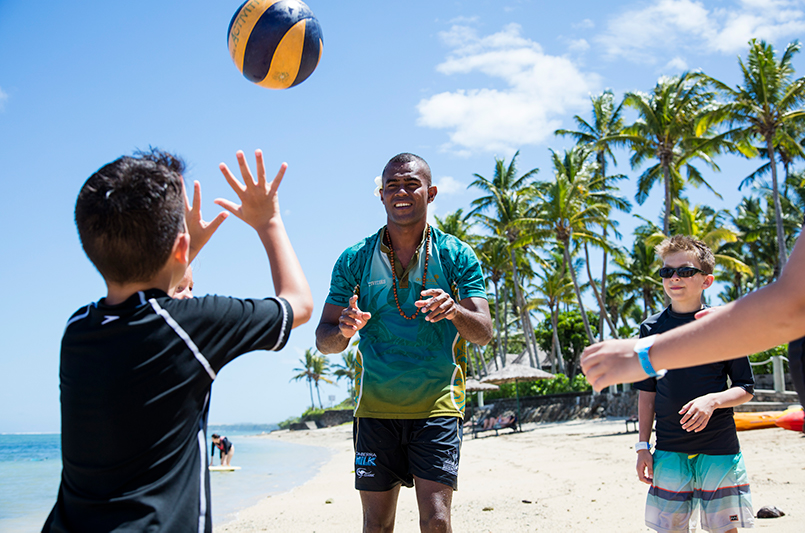 Kids playing ball on the beach at Outrigger Fiji Beach Resort