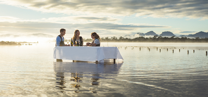 A couple enjoys fresh Pacific oysters and Champagne in a naturally significant wetland on Tasmania's east coast - 14 romantic experiences for valentines day