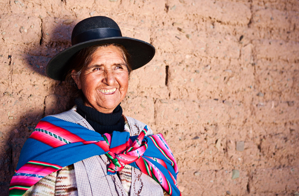 Smiling Bolivian woman in traditional dress