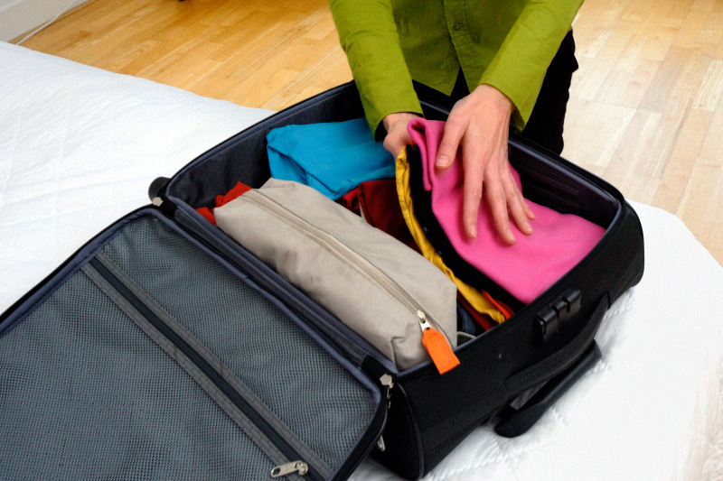 A woman packing her suitcase
