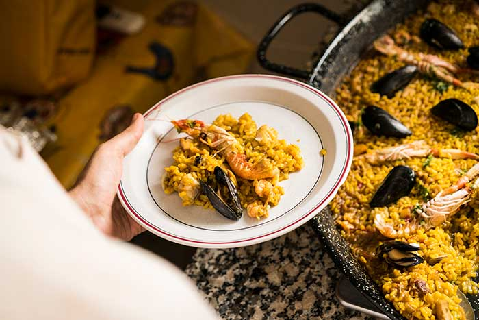 paella is a staple dish in Spain