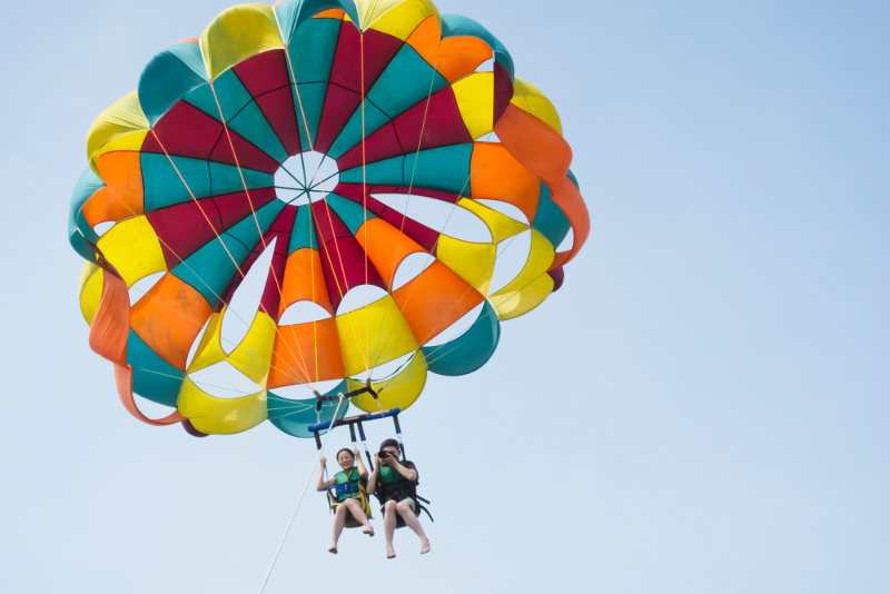 A pair of people in a parasail