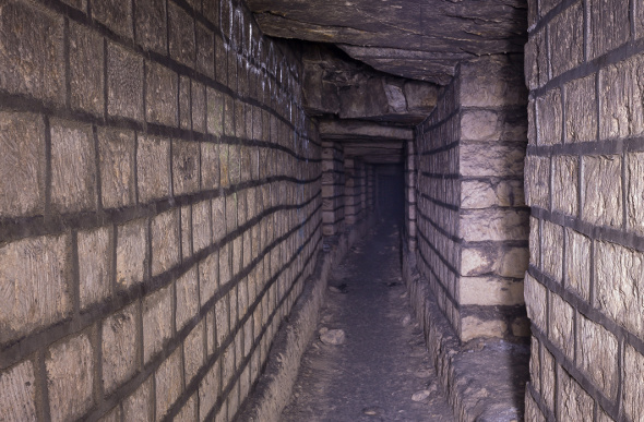 A view down a tunnel of the Paris Catacombs