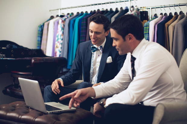 Two men having a discussion in a shop