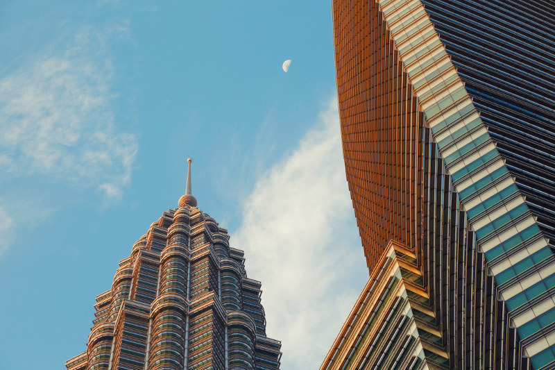 A view of the Petronas Twin Towers in Kuala Lumpur, Malaysia, highlighting its shape of an eight-pointed star.