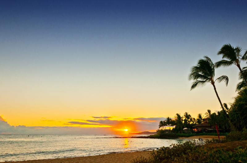 a view of the shoreline along Poipu Beach