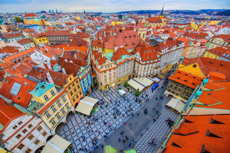 Tourists explore Prague's bustling Old Town Square.