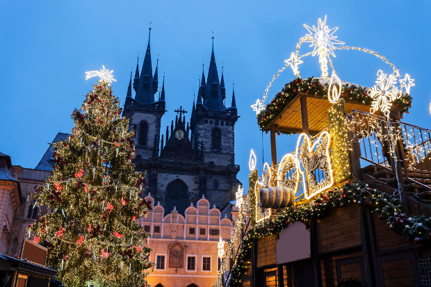 A view of an old building and Christmas lights in Prague