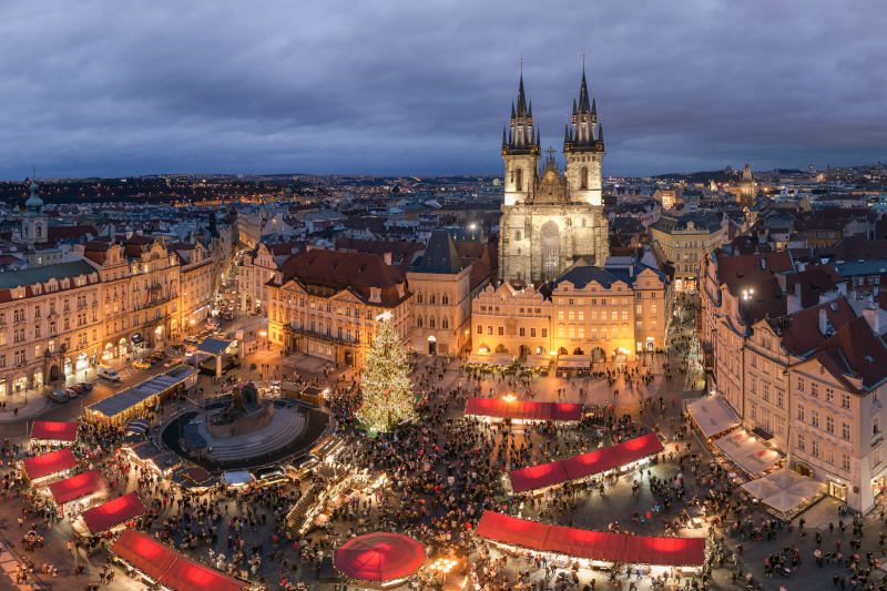 An aerial shot of the Prague Christmas markets. The cathedral is in the background