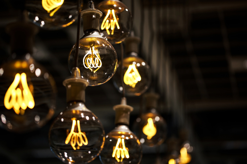Several lightbulbs hanging from a roof.