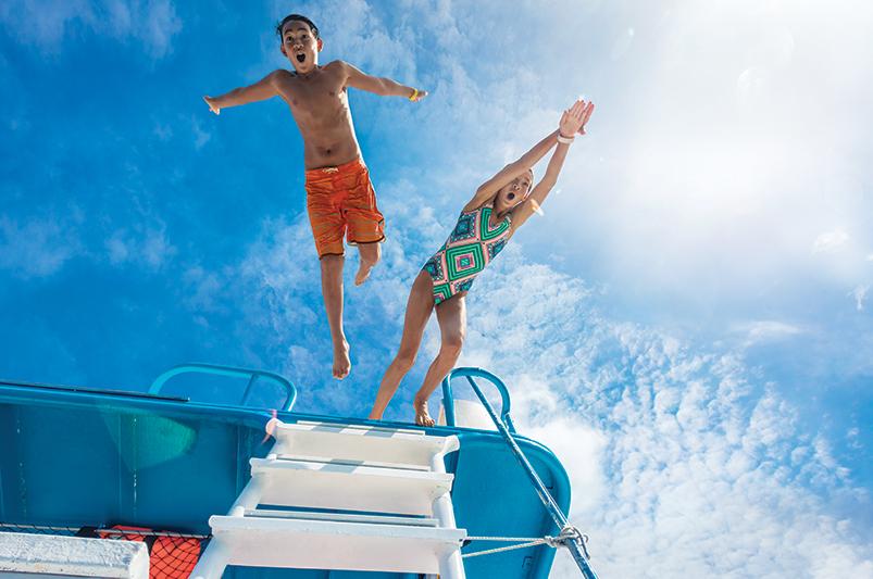 Kids jumping off a pontoon