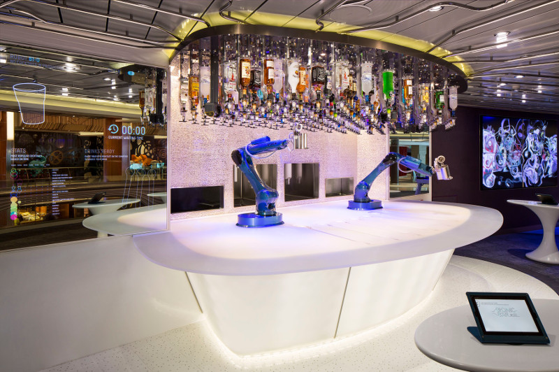 Robots serve drinks at Bionic Bar on board the Anthem of the Seas cruise ship.