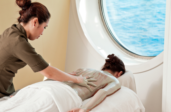 A woman getting a spa treatment on a cruise ship