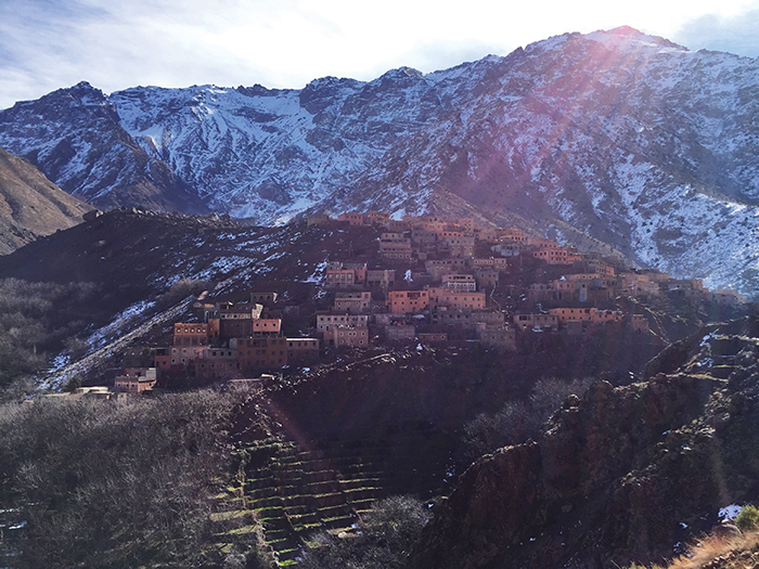The High Atlas range dwarfs a Berber village