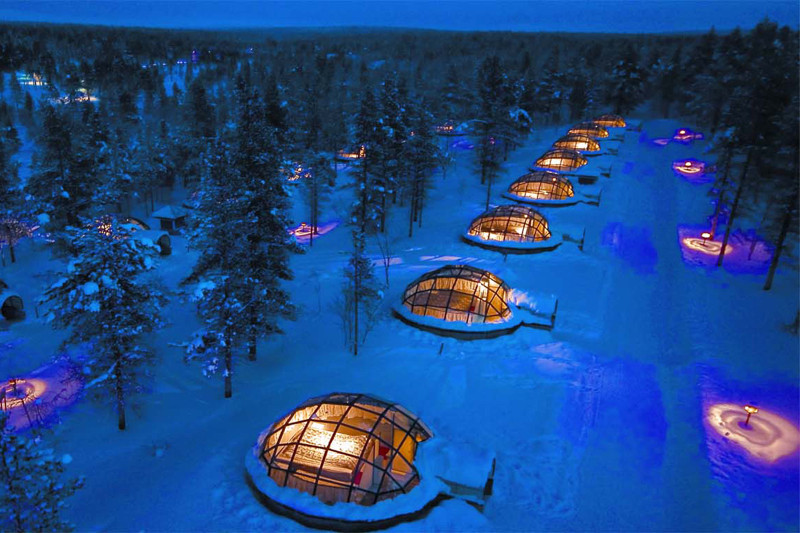 glass igloos in finland at night
