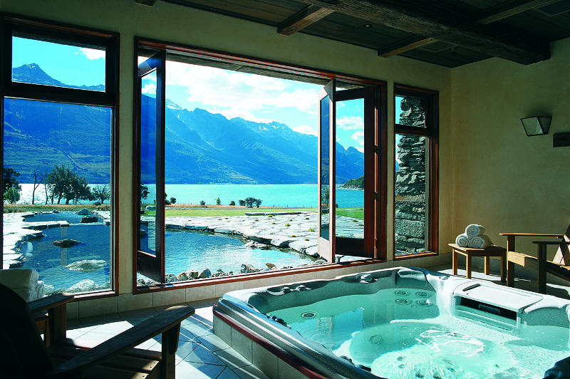 spa overlooking lake at blanket bay lodge new zealand