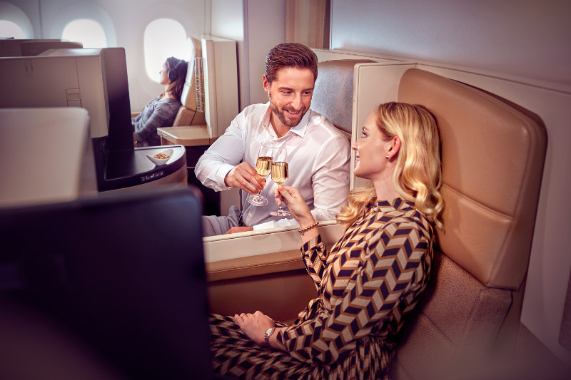 couple sharing champagne Business Class Etihad Airways