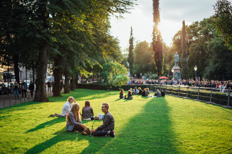 couple relaxing in park in Helsinki, Finland during summer