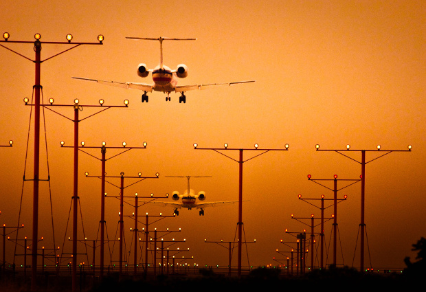 Planes arriving at LAX at sunset