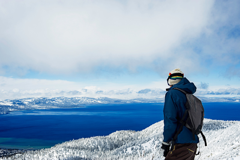 Skier overlooking Lake Tahoe, California