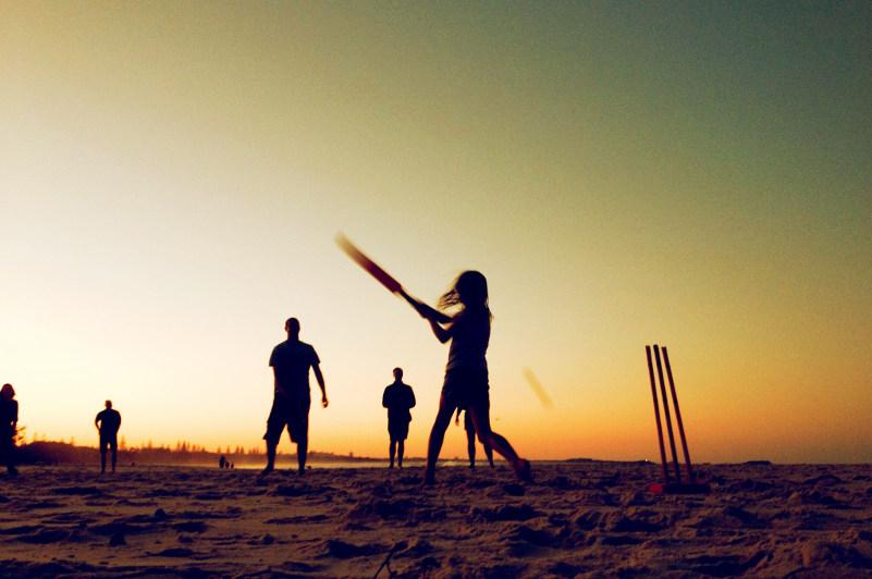 beach cricket at sunset
