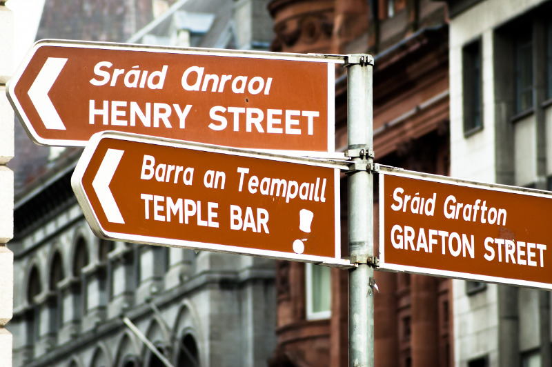 street sign in Dublin, Ireland, in English and Gaelic
