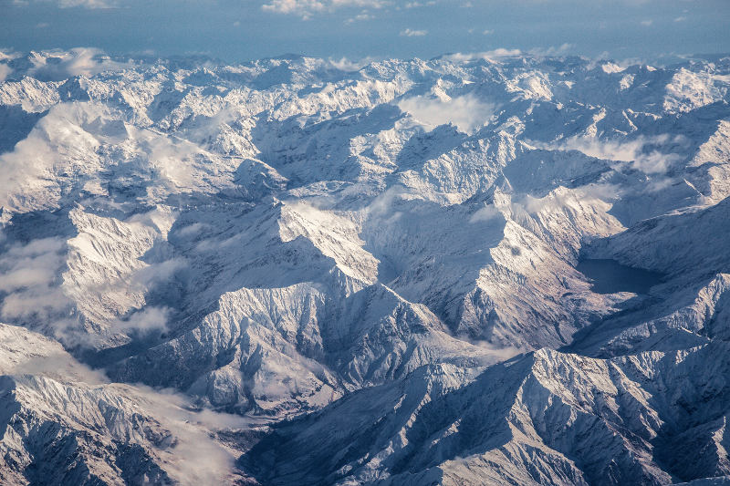 view of snow covered Queenstown mountains from the air