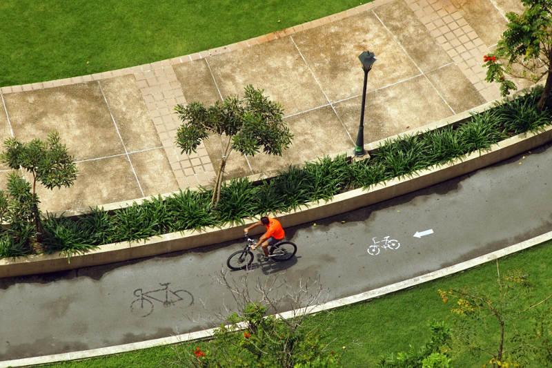 Man riding bicycle in Bangkok, Thailand