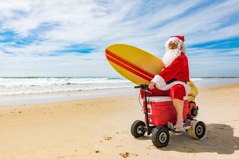 Santa on the beach with a ride-on esky