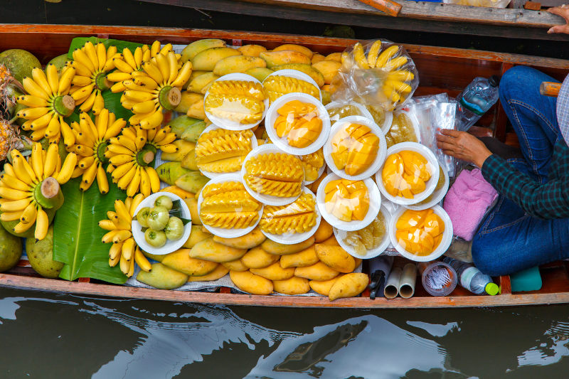 Longtail boat with fruit on it, from floating market near Bangkok