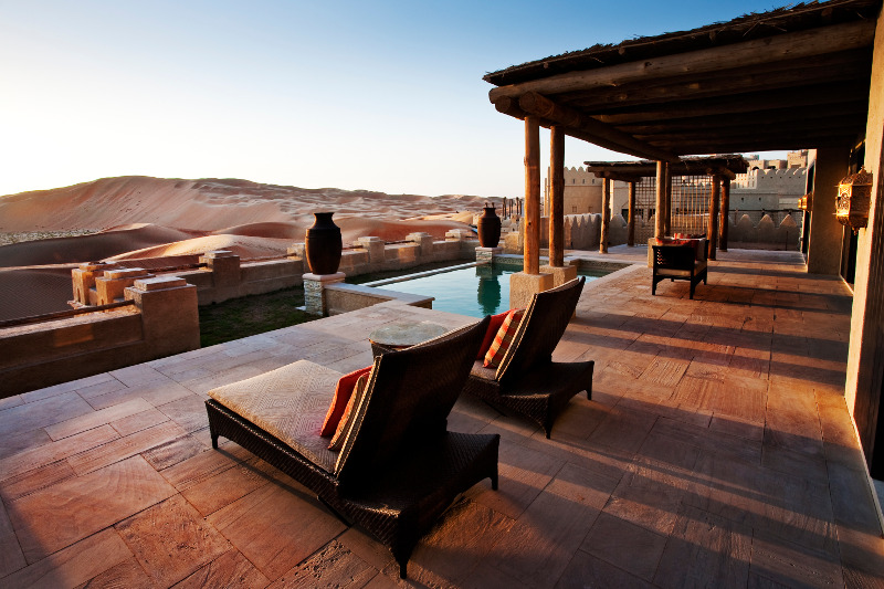 loungers overlooking pool luxury getaway in desert