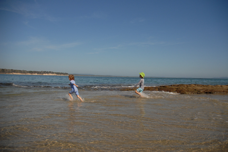 Two children having fun at the beach